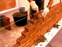 Handyman doing Masonry with bricks