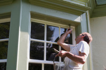 Handyman Doing Exterior House Painting