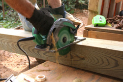 Handyman cutting a 4x4 with a circular saw